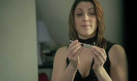 Blind woman putting on eyeliner in Dove Zebra Stripes ad