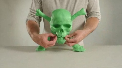 Green claymation skull in Xbox Bluckbusters ad