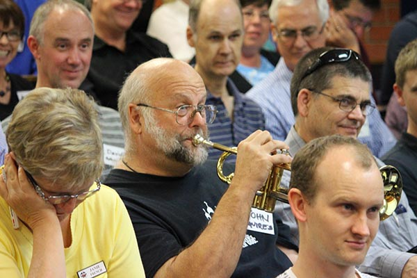 John Squires plays the trumpet at A Caler Call conference